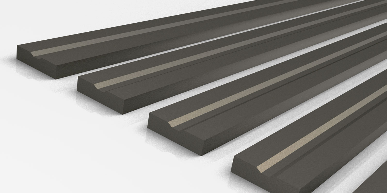 Grooved manganese wear rails
